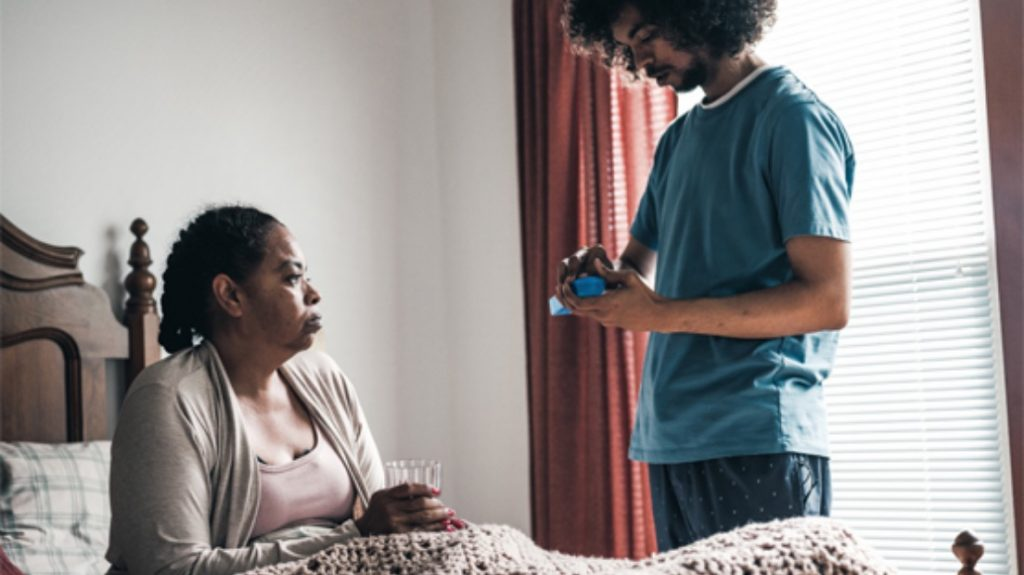 leah and her son aasad in the bedroom taking medication to help curb tobacco cravings